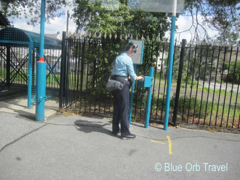 Conductor Lowering Traffic Barrier