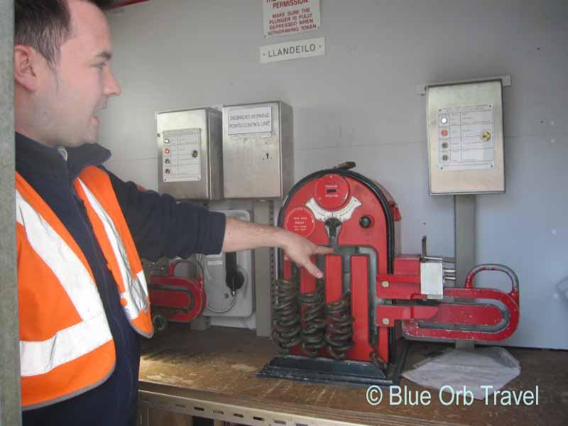 Engineer Explaining Old Train System